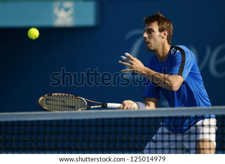 SYDNEY - JAN 11: Marcel Granollers volleys during his doubles semi final at the APIA Sydney Tennis International. Sydney January 11, 2013. - stock photo