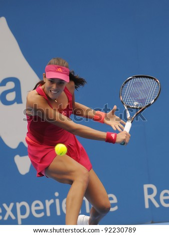 SYDNEY - JAN 8: Serbian Ana Ivanovic returns a serve during her first round match in the APIA Tennis International. Sydney - January 8, 2012 - stock photo
