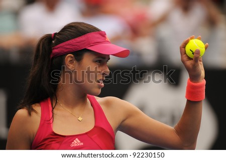 SYDNEY - JAN 8: Serbian Ana Ivanovic shows new balls during her first round match in the APIA Tennis International. Sydney - January 8, 2012 - stock photo