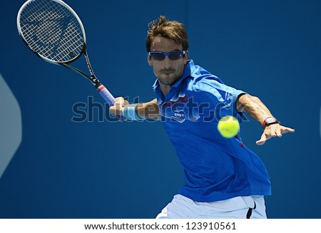 SYDNEY - JAN 8: Tommy Robredo from Spain hits a forehand in his first round match in the APIA Sydney Tennis International. Sydney January 8, 2013. - stock photo