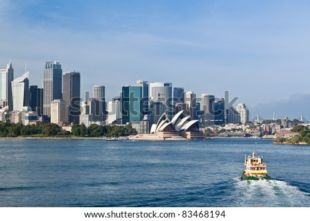 SYDNEY - JANUARY 04: A ferry crosses the harbor on January 04, 2011 in Sydney, Australia. Each year 172,000 ferry services are scheduled, carrying more than 14 million customers. - stock photo