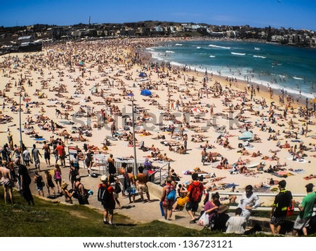 SYDNEY -JANUARY 1: People relaxing on the beach to celebrate new year on 1 January 2013 at Bondi beach in Sydney, Australia.Bondi beach is one of the most famous beach in the world. - stock photo