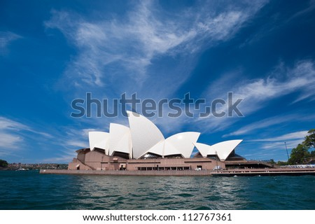 SYDNEY - JANUARY 12: The Iconic Sydney Opera House is a multi-venue performing arts centre also containing bars and outdoor restaurants.  January 12, 2012 in Sydney, Australia. - stock photo