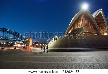 SYDNEY - JULY 21, 2010: Spectacular Sydney Harbour view at dusk on a winter day. The city attracts more than 10 million visitors every year. - stock photo