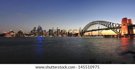 SYDNEY - JULY 6: View of Sydney and the Harbor on July 6, 2013 in Sydney, Australia. Over 10 millions tourists visit Sydney every year, making Sydney one of the world's top tourist destinations. - stock photo