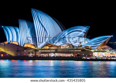 SYDNEY - June 10, 2016: Sydney Opera House in the night illuminated during Vivid Sydney Festival. Vivid Sydney is an annual outdoor Festival of Light, Music & Ideas in Sydney, Australia