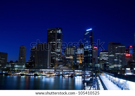 SYDNEY - MARCH 22: Sydney CBD view at night on March 22,2012 in Sydney. The Sydney central business district is the main commercial centre of Sydney, New South Wales, Australia. - stock photo