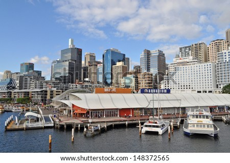 SYDNEY - MARCH 06: View of Sydney from Darling Harbour. Darling Harbour the city centre of Sydney is an area of entertainment facilities and a pedestrian walkway. March 06, 2012, Sydney, Australia. - stock photo