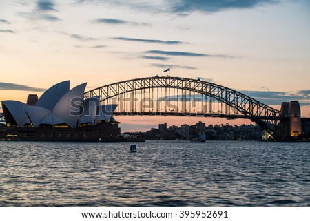 SYDNEY - MARCH 24: View of the iconic Sydney Opera House and the Sydney Harbour Bridge at sunset from Mrs. Macquarie's Chair on March 24, 2016 in Sydney, Australia. - stock photo