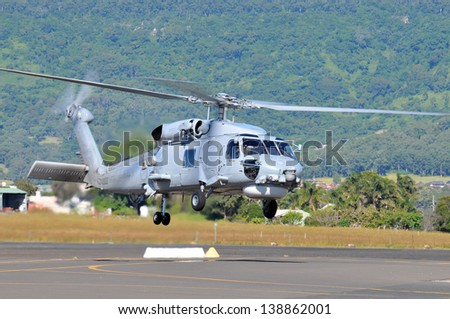 SYDNEY - MAY 5: A Seahawk military helicopter takes off during the Wings Over Illawarra Airshow on May, 2013 near Sydney. - stock photo
