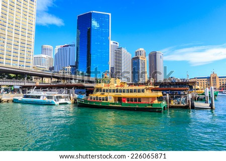 SYDNEY - MAY 11: Circular Quay Ferry Wharf on May 11, 2014 in Sydney. It is part of the Sydney Ferries network, and it is the terminus for all public ferry routes in Sydney. - stock photo