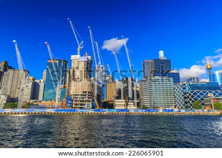 SYDNEY - MAY 12: City scape of Darling Harbour on May 12, 2014 in Sydney. The harbour is a large recreational and pedestrian precinct that is situated on western outskirts of the Sydney. - stock photo