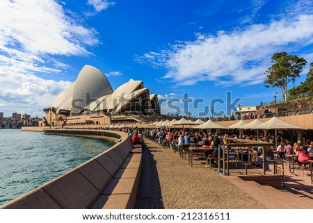 SYDNEY - MAY 10: Opera House on May 10, 14 in Sydney. It is Identified as one of the 20th century's most distinctive buildings and one of the most famous performing arts centres in the world. - stock photo