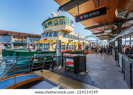 SYDNEY - MAY 12:  Passengers at Circular Quay Ferry Wharf  on May 12, 2014 in Sydney. It is part of the Sydney Ferries network, and it is the terminus for all public ferry routes in Sydney. - stock photo