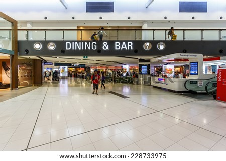SYDNEY- MAY 17 : Passengers in Departure terminal of Sydney (Kingsford Smith) Airport, Sydney, Australia on May 17, 2014. It is the only major airport serving Sydney, and is a primary hub for Qantas. - stock photo