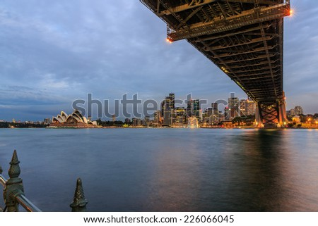 SYDNEY - MAY 10: Sydney Harbor Bridge on May 10, 2014 in Sydney. It is a steel arch bridge across Sydney Harbor that carries rail, vehicle and pedestrian traffic between the city and the North Shore. - stock photo