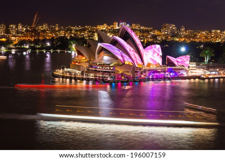 SYDNEY - MAY 31, 2014: Sydney Opera House shown during Vivid Sydney: A Festival of Light, Music & Ideas in Sydney, Australia. - stock photo
