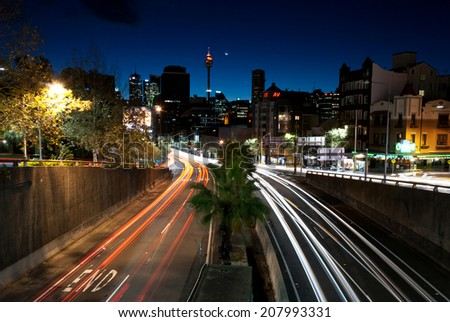 Sydney Night, June 29. 2014. Night time long exposure shot from Kings Cross, William St. in Sydney, Australia. - stock photo