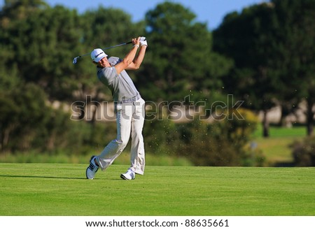 SYDNEY - NOV 11: American golfer Dustin Johnson plays a fairway shot at the Emirates Australian Open at The Lakes golf course. Sydney, November 11, 2011 - stock photo