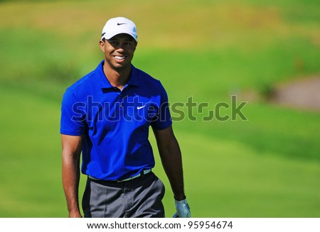 SYDNEY - NOV 12: American Tiger Woods smiles to the crowd at the Emirates Australian Golf Open in Sydney, Australia on November 12, 2011 - stock photo
