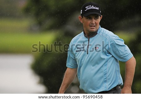 SYDNEY - NOV 10: Australia's Greg Chalmers playing in rain first round of the Australian Golf Open in Sydney, Australia on November 10, 2011.