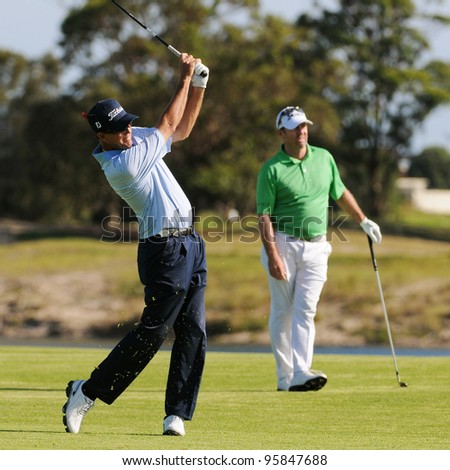 SYDNEY - NOV 11: Australian Stephen Leaney plays his second shot at the 17th in his second roound at the Emirates Australian Golf Open. Sydney - November 11, 2011 - stock photo