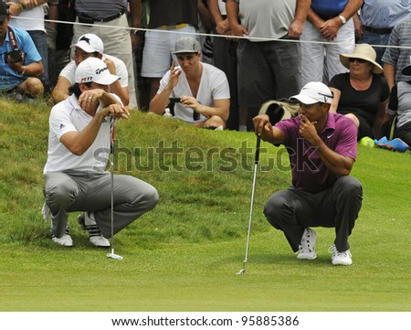 SYDNEY - NOV 10: Tiger Woods and Jason Day at the Emirates Australian Golf Open. Sydney - November 10, 2011 - stock photo