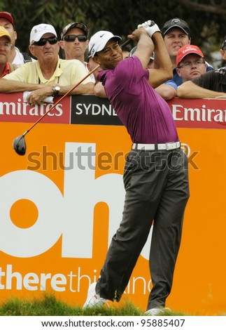 SYDNEY - NOV 10: Tiger Woods drives at the Emirates Australian Golf Open. Sydney - November 10, 2011 - stock photo