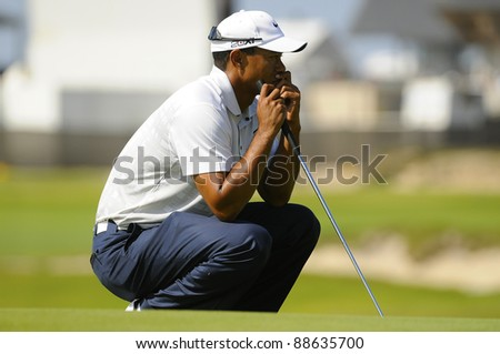 SYDNEY - NOV 11: Tiger Woods examines his putt in the second round in the Australian Open at The Lakes golf course. Sydney, November 11, 2011 - stock photo