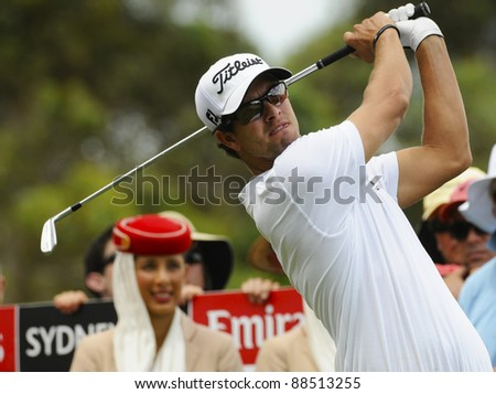 SYDNEY - NOVEMBER 10: Adam Scott plays a tee shot in the first round in the Australian Open at The Lakes golf course on November 10, 2011 in Sydney, Australia. - stock photo