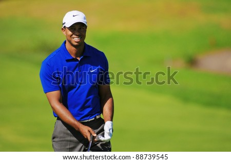 SYDNEY - NOVEMBER 12 - American golfer Tiger Woods plays a iron from the fairway third round at the Emirates Australian Open at The Lakes golf course. Sydney - November 12, 2011 - stock photo
