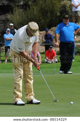 SYDNEY - NOVEMBER 10: John Daly putts in the first round in the Australian Open at The Lakes golf course on November 10, 2011 in Sydney, Australia.