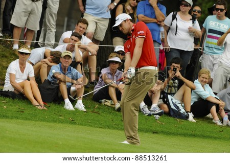 SYDNEY - NOVEMBER 10: Nick Watney plays a chip shot in the first round in the Australian Open at The Lakes golf course on November 10, 2011 in Sydney, Australia. - stock photo