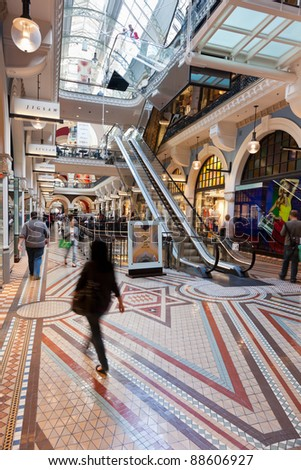 SYDNEY - NOVEMBER 4: Shoppers in the The Queen Victoria Building on November 4, 2011. First opened in 1820 as a market selling grains, livestock, fabric and groceries it is now a premium retail mall. - stock photo