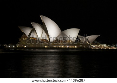 SYDNEY - NOVEMBER 20: Sydney Opera House in Australia at night on Nov. 20th 2009. The Opera House was made a UNESCO World Heritage Site on 28 June 2007 and is one of the world's most famous landmarks. - stock photo