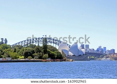 SYDNEY - NOVEMBER 22: The Iconic Sydney Opera House and the Harbour Bridge is a multi-venue performing  arts centre also containing bars and outdoor restaurants. November 22, 2013 in Sydney, Australia - stock photo
