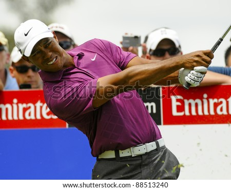 SYDNEY - NOVEMBER 10: Tiger Woods plays a tee shot in the first round in the Australian Open at The Lakes golf course on November 10, 2011 in Sydney, Australia. - stock photo