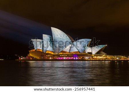 SYDNEY, NSW, AUSTRALIA - MAY 29, 2014: Sydney Opera House lit with vibrant colors patterns and moving imagery during the annual Vivid Sydney festival.