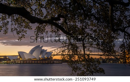 Sydney, NSW/Australia-October 14 : Sunset at Opera house from Botanic garden. locate in Sydney harbour on October 14, 2013. - stock photo