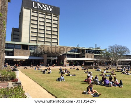 SYDNEY, NSW, AUSTRALIA - September 23, 2014: Students relaxing in front of the main library lawn, The University of New South Wales (UNSW) - stock photo