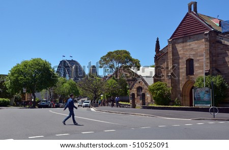 SYDNEY - OCT 18 2016: Person crossing the road towards the Garrison Church at The Rocks in Sydney, Australia.It was the first military church built in colonial Australia in 1840.