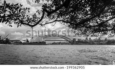 Sydney opera house and harbor bridge in black and white - stock photo