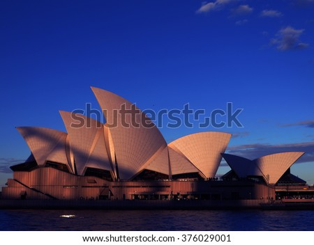 Sydney Opera House at Sunset, with the shadow of the Sydney Harbour Bridge imposed on its iconic sails. Sydney, New South Wales, Australia - stock photo