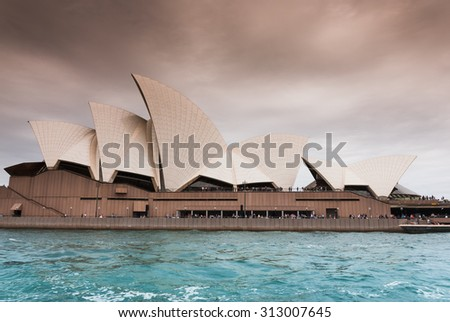 SYDNEY OPERA HOUSE, CENTRAL BUSINESS DISTRICT, SYDNEY, NSW AUSTRALIA - DECEMBER 27, 2014: Multipurpose art centre and famous tourist attraction, UNESCO World Heritage Site - close skyline boat view  - stock photo