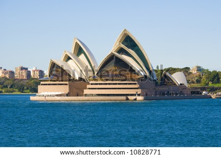 Sydney Opera House on a perfect day. Clear blue sky, gentle blue harbour