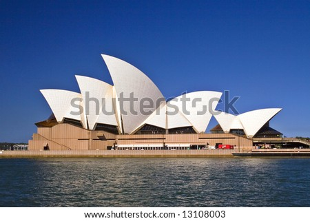 Sydney Opera House, pictured from ferry departing Circular Quay. - stock photo