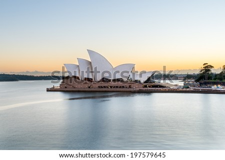 Sydney Opera House Sunrise - December 12: The Iconic Sydney Opera House is a multi-venue performing arts centre also containing bars and outdoor restaurants. January 12, 2014 in Sydney, Australia. - stock photo