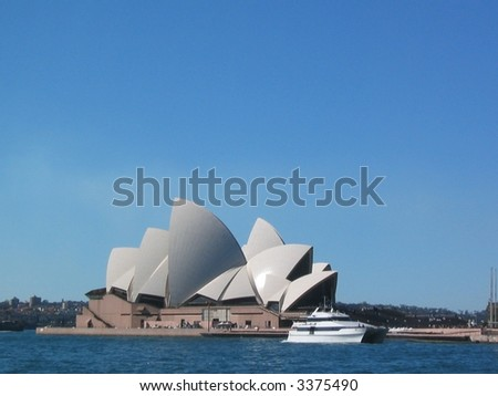 sydney opera house with a harbor ferry  on a bright, sunny day