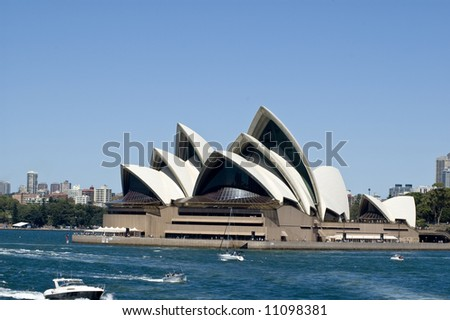 sydney opera house with boats in foregournd taken from harbor