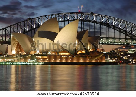 Sydney Opera House with Harbour Bridge at night detail - stock photo